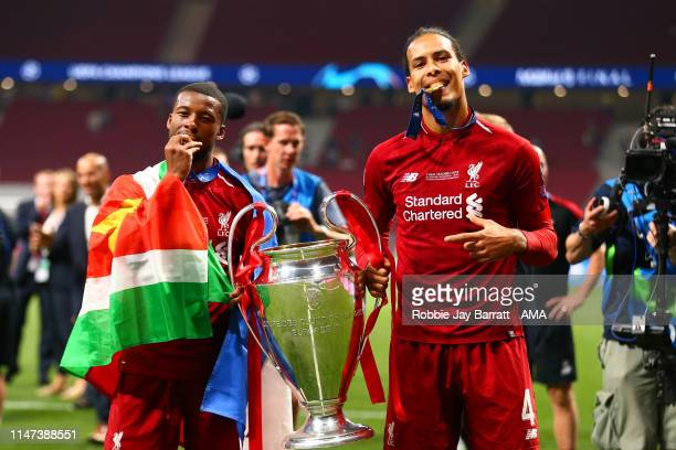 Virgil van Dijk of Liverpool celebrates with Georginio Wijnaldum of Liverpool at the end of the UEFA Champions League Final between Tottenham Hotspur...