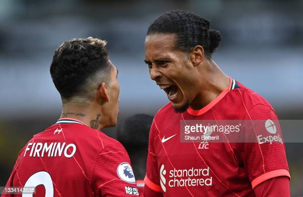 Virgil Van Dijk of Liverpool celebrates with Roberto Firmino after the second goal during the Premier League match between Norwich City and Liverpool...
