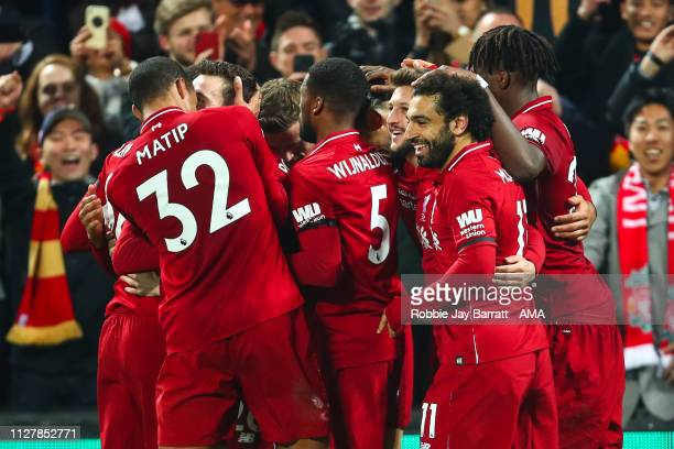 Virgil van Dijk of Liverpool celebrates with team mates after he scores a goal to make it 50 during the Premier League match between Liverpool FC and...