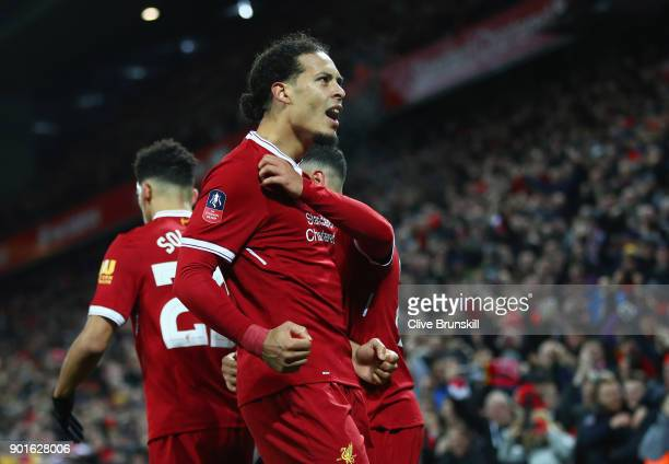 Virgil van Dijk of Liverpool celebrates with team mates as he scores their second goal during the Emirates FA Cup Third Round match between Liverpool...