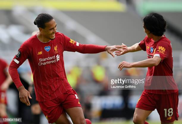 Virgil van Dijk of Liverpool celebrates with teammate Takumi Minamino after scoring his team's first goal during the Premier League match between...