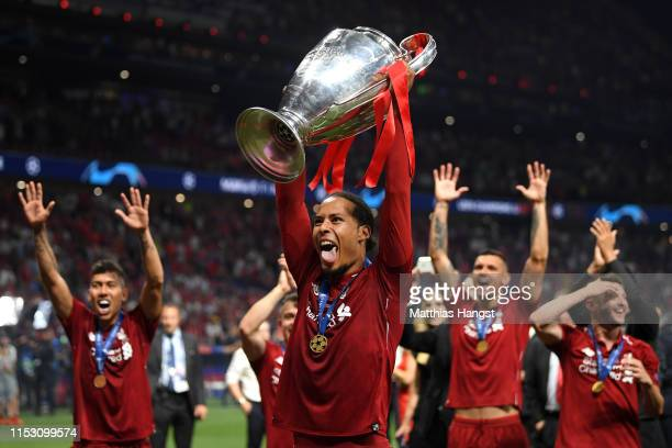 Virgil van Dijk of Liverpool celebrates with the Champions League Trophy after winning the UEFA Champions League Final between Tottenham Hotspur and...
