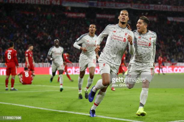 Virgil van Dijk of Liverpool celerbates as he scores his team's second goal with Roberto Firmino during the UEFA Champions League Round of 16 Second...