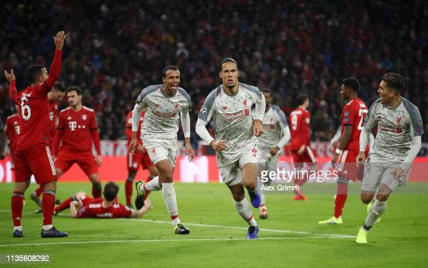 Virgil van Dijk of Liverpool celerbates as he scores his team's second goal with Roberto Firmino and Joel Matip during the UEFA Champions League...