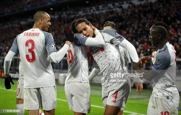 Virgil van Dijk of Liverpool celerbates as he scores his team's second goal with team mates during the UEFA Champions League Round of 16 Second Leg...