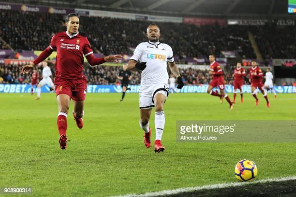 Virgil van Dijk of Liverpool challenges Jordan Ayew of Swansea City during the Premier League match between Swansea City and Liverpool at The Liberty...