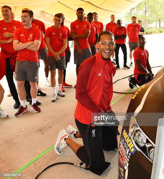 Virgil van Dijk of Liverpool changing tyres during a tour of Roush Fenway Racing on July 21 2018 in Charlotte North Carolina