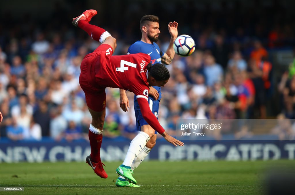 Virgil van Dijk of Liverpool collides with Olivier Giroud of Chelsea during the Premier League match between Chelsea and Liverpool at Stamford Bridge on May 6, 2018 in London, England.