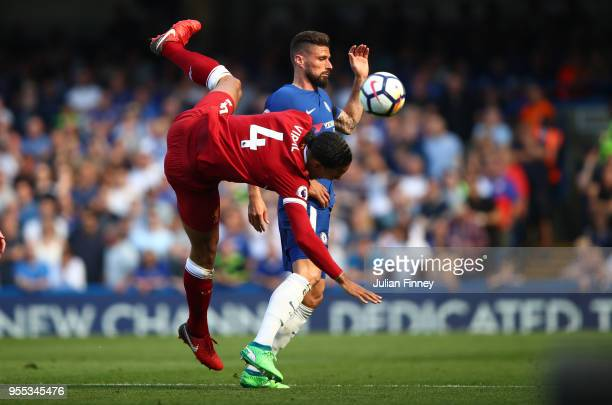 Virgil van Dijk of Liverpool collides with Olivier Giroud of Chelsea during the Premier League match between Chelsea and Liverpool at Stamford Bridge...