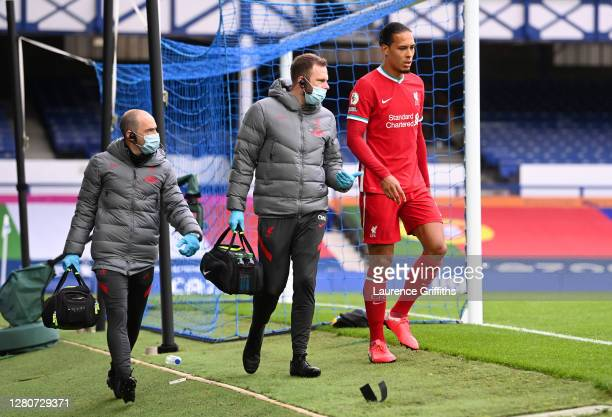 Virgil van Dijk of Liverpool comes off due to an injury during the Premier League match between Everton and Liverpool at Goodison Park on October 17,...