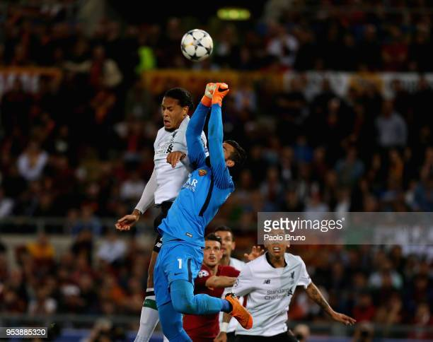 Virgil Van Dijk of Liverpool competes for the ball with AS Roma goalkeeper Becker Alisson during the UEFA Champions League Semi Final Second Leg...