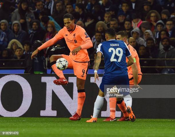 Virgil van Dijk of Liverpool competes with Francisco Soares of FC Porto during the UEFA Champions League Round of 16 First Leg match between FC Porto...