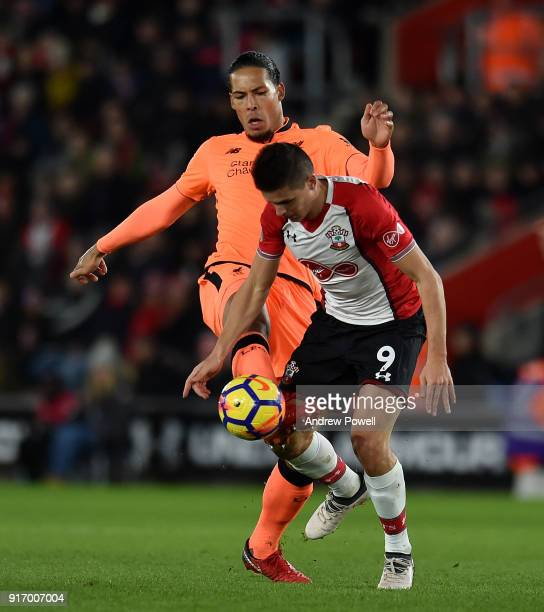 Virgil van Dijk of Liverpool competes with Guido Carrillo of Southampton during the Premier League match between Southampton and Liverpool at St...