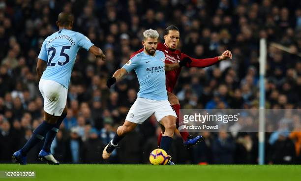 Virgil van Dijk of Liverpool competes with Sergio Aguero of Manchester City during the Premier League match between Manchester City and Liverpool FC...