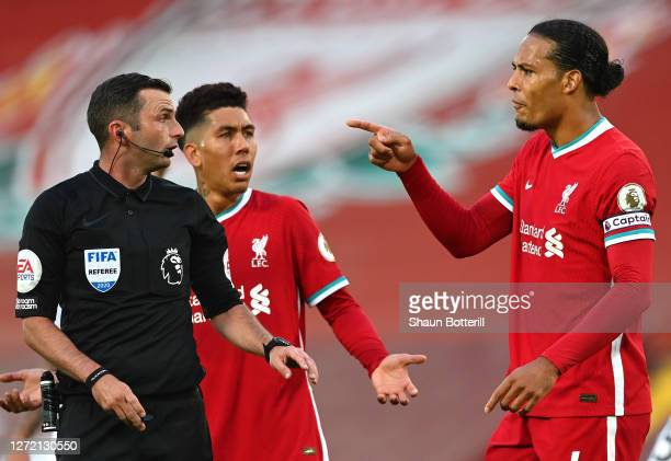 Virgil van Dijk of Liverpool confronts referee Michael Oliver during the Premier League match between Liverpool and Leeds United at Anfield on...