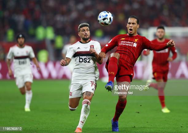 Virgil van Dijk of Liverpool controls the ball as he is put under pressure by Giorgian De Arrascaeta of CR Flamengo during the FIFA Club World Cup...