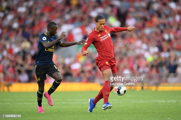 Virgil van Dijk of Liverpool controls the ball during the Premier League match between Liverpool FC and Arsenal FC at Anfield on August 24 2019 in...