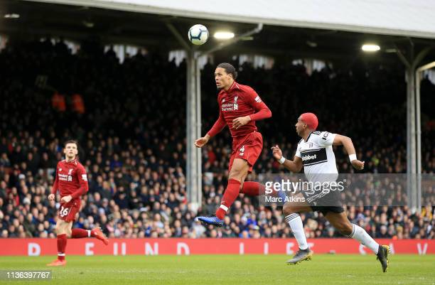 Virgil van Dijk of Liverpool controls the ball with his head during the Premier League match between Fulham FC and Liverpool FC at Craven Cottage on...