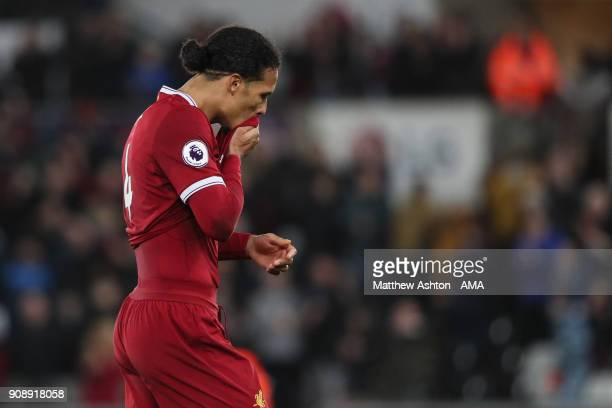 Virgil van Dijk of Liverpool dejected at full time during the Premier League match between Swansea City and Liverpool at Liberty Stadium on January...
