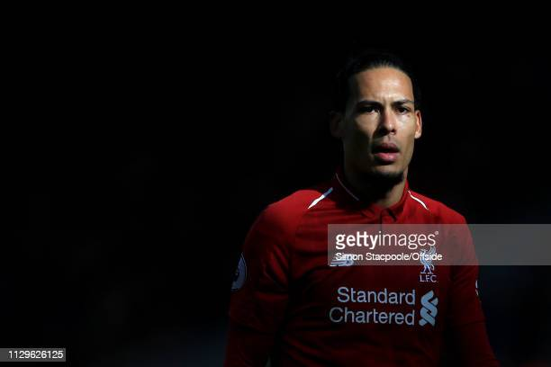 Virgil van Dijk of Liverpool emerges from the shadows during the Premier League match between Liverpool and Burnley at Anfield on March 10 2019 in...