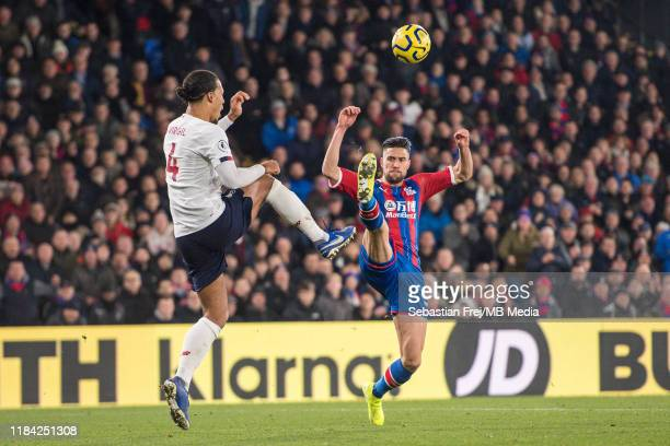 Virgil van Dijk of Liverpool FC and Martin Kelly of Crystal Palace in action during the Premier League match between Crystal Palace and Liverpool FC...