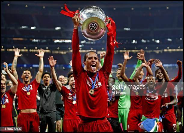Virgil van Dijk of Liverpool FC lifts the trophy after winning the UEFA Champions League final during the UEFA Champions League final match between...
