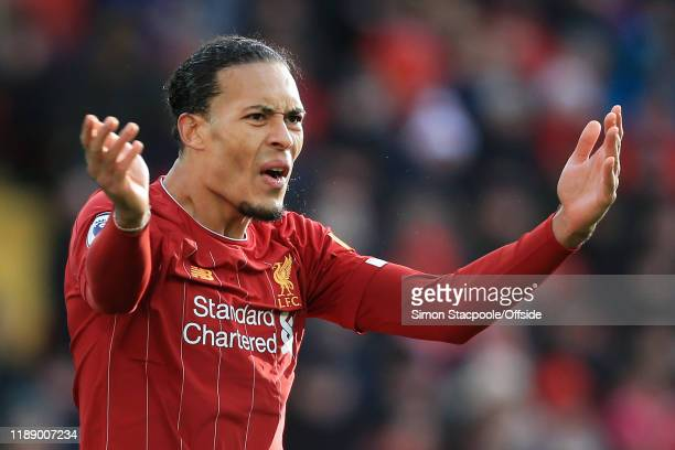 Virgil van Dijk of Liverpool gestures during the Premier League match between Liverpool FC and Watford FC at Anfield on December 14 2019 in Liverpool...