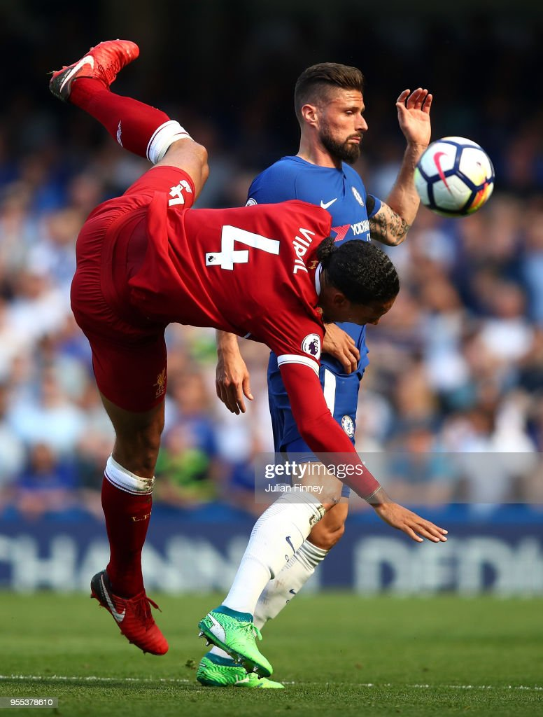 Virgil Van Dijk of Liverpool goes flying under pressure from Olivier Giroud of Chelsea during the Premier League match between Chelsea and Liverpool at Stamford Bridge on May 6, 2018 in London, England.