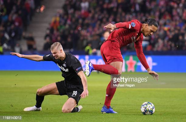 Virgil van Dijk of Liverpool goes past Erling Haland of Red Bull Salzburg during the UEFA Champions League group E match between RB Salzburg and...