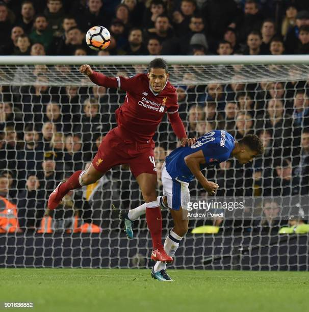 Virgil van Dijk of Liverpool goes up with Dominic CalvertLewin of Everton during The Emirates FA Cup Third Round match between Liverpool and Everton...