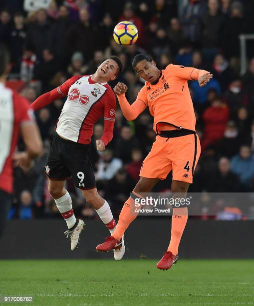 Virgil van Dijk of Liverpool goes up with Guido Carrillo of Southampton during the Premier League match between Southampton and Liverpool at St...