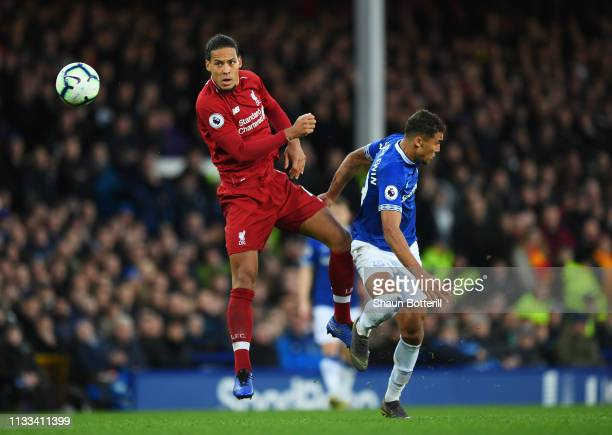 Virgil van Dijk of Liverpool heads away from Dominic CalvertLewin of Everton during the Premier League match between Everton FC and Liverpool FC at...