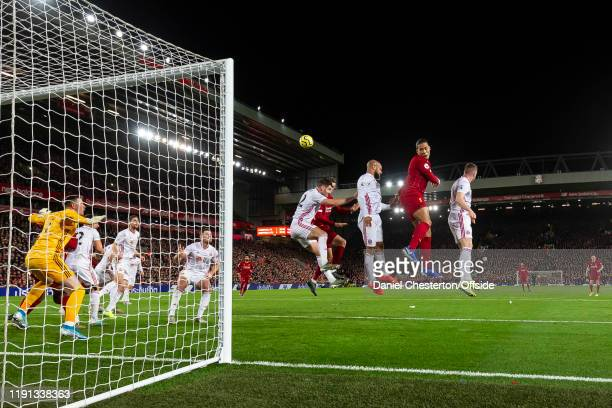 Virgil van Dijk of Liverpool heads the ball at goal during the Premier League match between Liverpool FC and Sheffield United at Anfield on January 2...