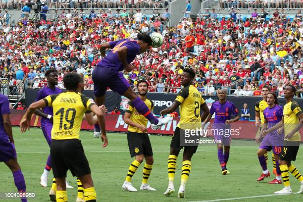 Virgil van Dijk of Liverpool heads the ball for a score off of a corner kick in the first half during the International Champions Cup soccer match...