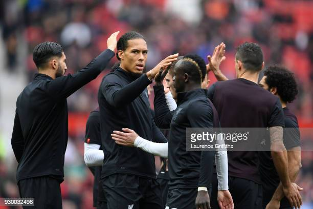 Virgil van Dijk of Liverpool high fives Sadio Mane of Liverpool ahead of the Premier League match between Manchester United and Liverpool at Old...