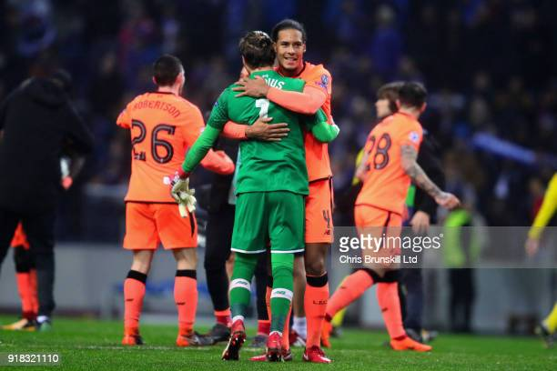 Virgil van Dijk of Liverpool hugs Lorus Karius of Liverpool after the UEFA Champions League Round of 16 First Leg match between FC Porto and...