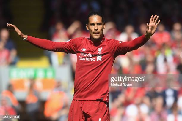 Virgil van Dijk of Liverpool in action during the Premier League match between Liverpool and Brighton and Hove Albion at Anfield on May 13 2018 in...