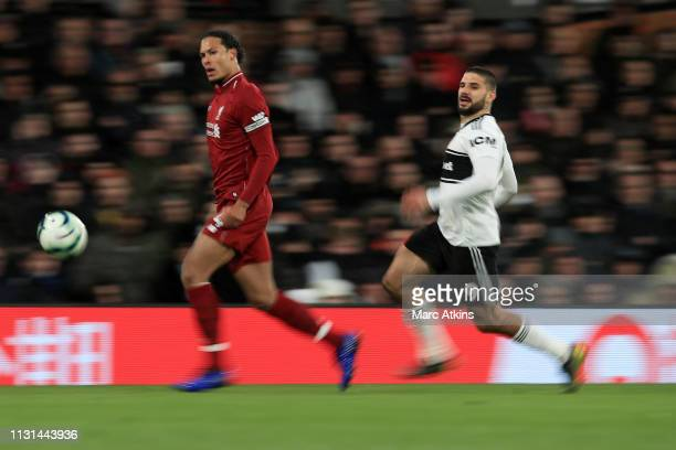 Virgil van Dijk of Liverpool in action with Aleksandar Mitrovic of Fulham during the Premier League match between Fulham FC and Liverpool FC at...