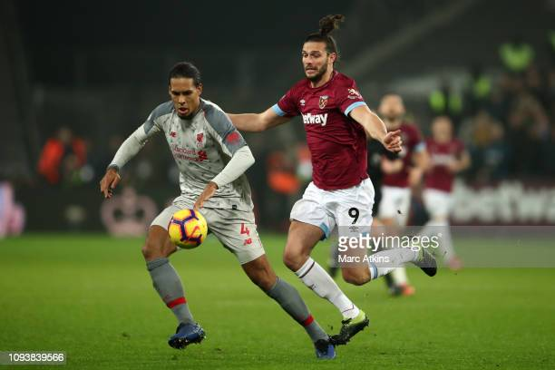 Virgil van Dijk of Liverpool in action with Andy Carroll of West Ham United during the Premier League match between West Ham United and Liverpool FC...