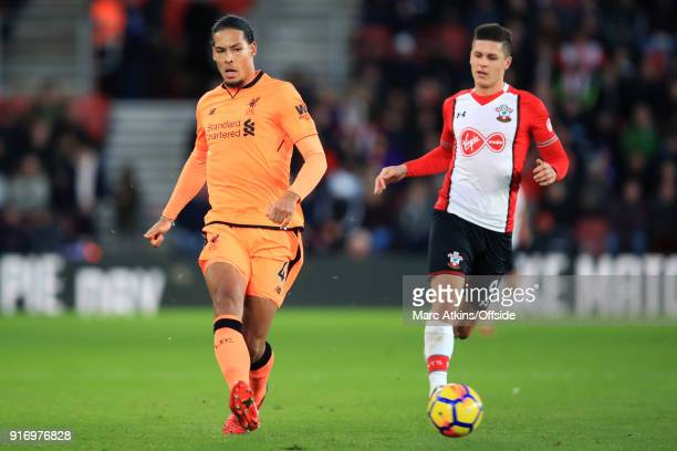 Virgil van Dijk of Liverpool in action with Guido Carrillo of Southampton during the Premier League match between Southampton and Liverpool at St...