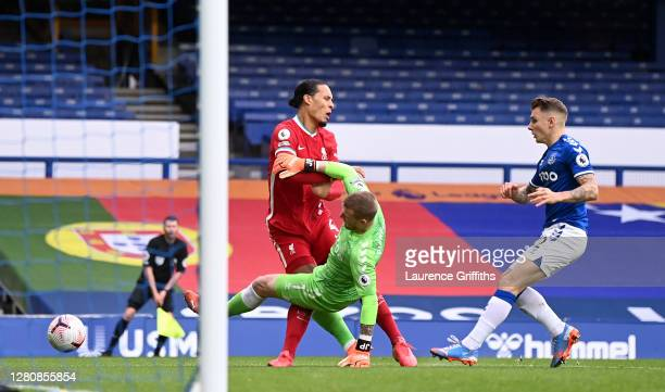 Virgil van Dijk of Liverpool is tackled by Jordan Pickford of Everton which led to Virgil van Dijk being substituted for an injury during the Premier...