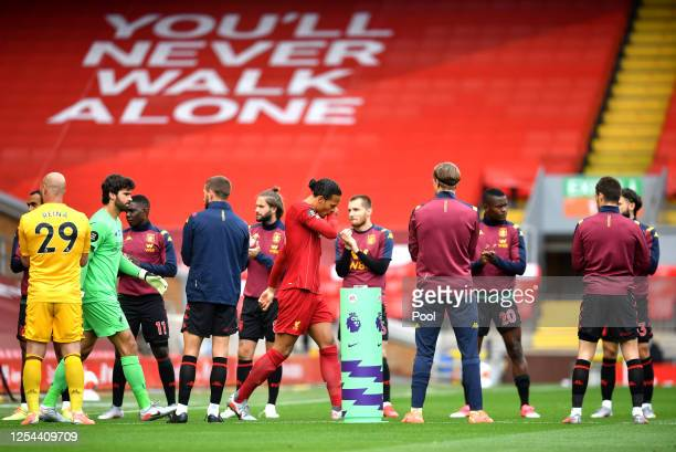 Virgil van Dijk of Liverpool leads his teammates out to the pitch through a guard of honor by Aston Villa players prior to the Premier League match...
