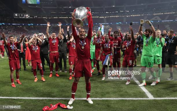 Virgil van Dijk of Liverpool lifts the Champions League Trophy after winning the UEFA Champions League Final between Tottenham Hotspur and Liverpool...