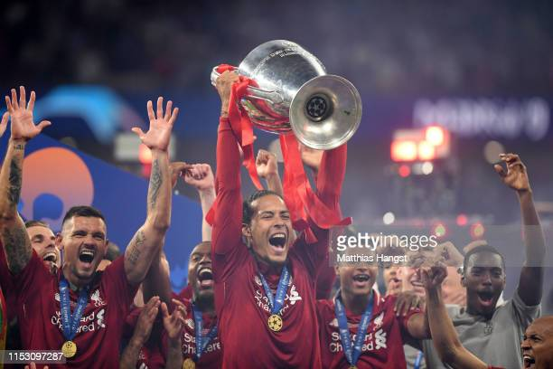 Virgil van Dijk of Liverpool lifts the Champions League Trophy following the UEFA Champions League Final between Tottenham Hotspur and Liverpool at...