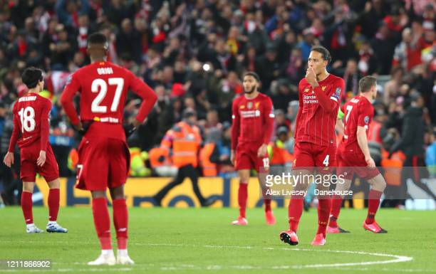 Virgil van Dijk of Liverpool looks dejected after they concede the third goal during the UEFA Champions League round of 16 second leg match between...