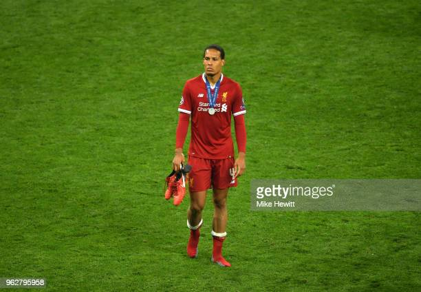 Virgil van Dijk of Liverpool looks dejected following his sides defeat in the UEFA Champions League Final between Real Madrid and Liverpool at NSC...