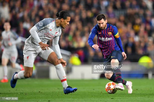 Virgil van Dijk of Liverpool looks on as Lionel Messi of Barcelona controls the ball during the UEFA Champions League Semi Final first leg match...