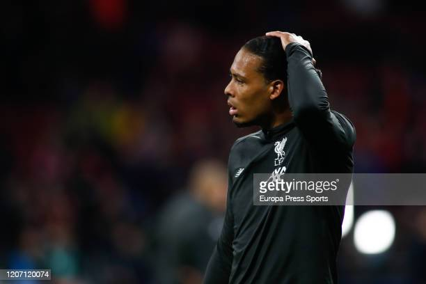 Virgil Van Dijk of Liverpool looks on during the UEFA Champions League football match round 16 played between Atletico de Madrid and Liverpool FC at...