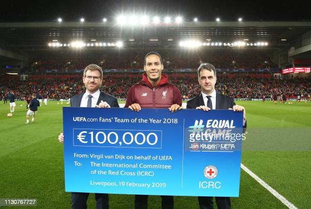 Virgil van Dijk of Liverpool participates in the ICRC Cheque Handover prior to the UEFA Champions League Round of 16 First Leg match between...