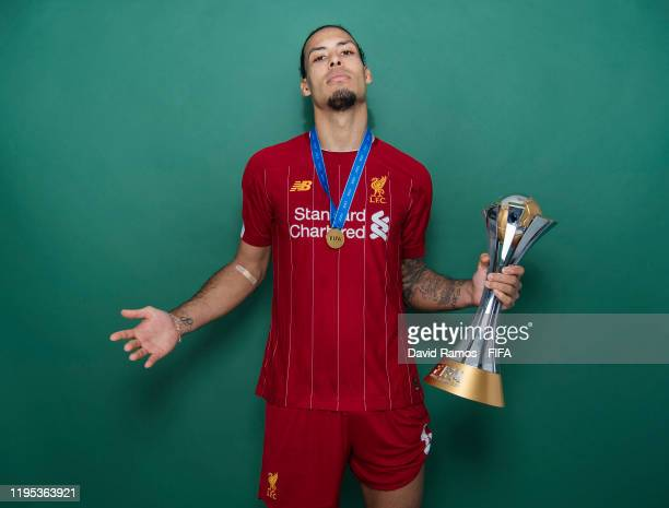 Virgil van Dijk of Liverpool poses with the Club World Cup trophy after the FIFA Club World Cup Qatar 2019 Final match between Liverpool and CR...